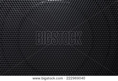 Black grill from the speakers. black speaker can be used as background