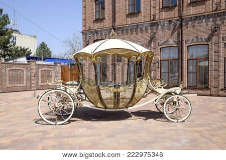 Poltavskaya, Russia - April 07, 2016: forged carriage on the site near the building. Beautiful decorative coach.
