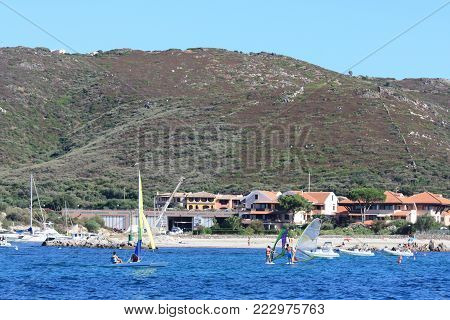 GOLFO DI MARINELLA, SARDINIA, ITALY - AUGUST 5, 2009 - People practicing water sports at Golfo di Marinella, an ample natural bay gathering many small coves and stunning white sand beaches, just a few kilometres away from Porto Rotondo.
