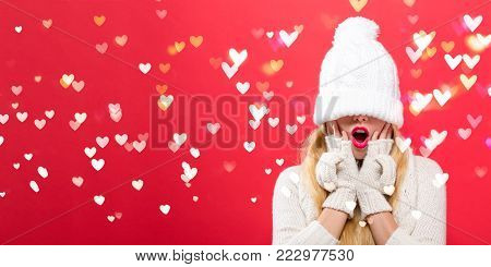 Woman with a winter knit hat pulled over her eyes with heart lights