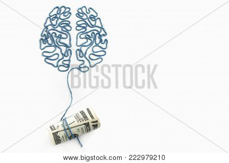 Brain and money connected by a thread on a white background
