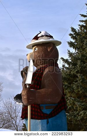INTERNATIONAL FALLS, MINNESOTA, January 19, 2017:  Smokey the Bear, holding a shovel, is a symbol of forest fire prevention throughout the United States  managed by the Forest Service.