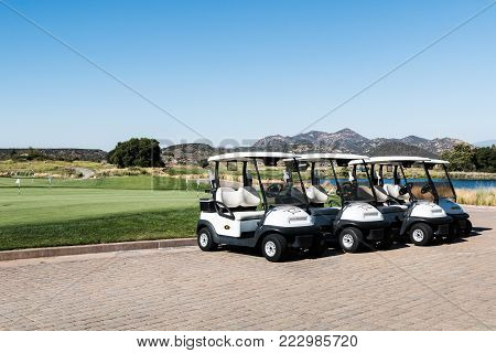 LAKESIDE, CALIFORNIA - JUNE 18, 2017:  A row of golf carts at Barona Creek Golf Club, an 18-hole course at the Barona Resort and Casino in San Diego, an Indian gaming casino.