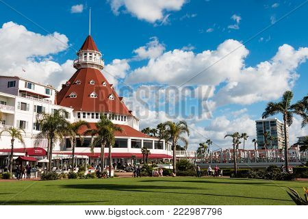 CORONADO, CALIFORNIA - JANUARY 20, 2018:  The courtyard and main building of the Hotel del Coronado. This historic beachfront hotel, built in 1888, was formerly the largest resort hotel in the world.