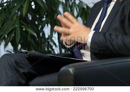 Businessman boss or politician giving interview. Close up shot.