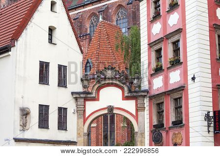 Two medieval tenement houses called Jas i Malgosia, connected by arcades with cartouche with the inscription: Death, the gate of life,  Market Square, Wroclaw, Poland poster