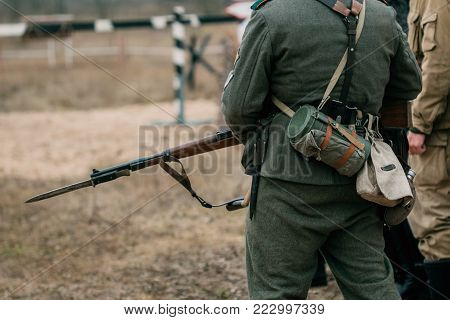 Ammunition and uniform of the German soldier Wehrmacht with a rifle and bayonet knife