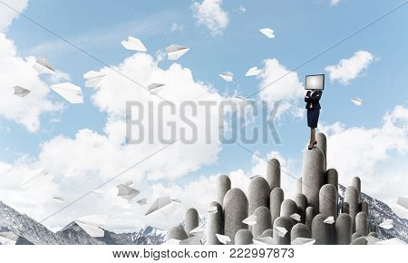 Business woman in suit with monitor instead of head keeping arms crossed while standing on the top of stone columns among flying paper planes with beautiful landscape on background. 3D rendering.