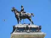a statue detail of King Alfonso XII Retiro Madrid Spain poster