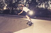 young American man practicing radical skate board having fun enjoying tricks jumps and stunts in concrete half pipe skating track in sport and healthy lifestyle concept poster