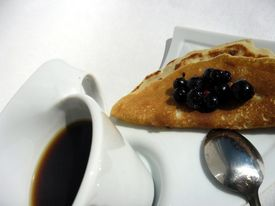 Coffee with pancake and berries