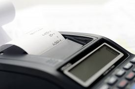 Printing calculator or accounting calculator with blur effect,  low depth of field, focus on printing roll