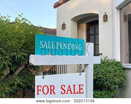 Close Up On For Sale And Sale Pending Sign In Front Of A California Home. Housing Crisis, Selling Ho