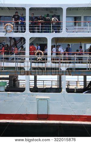 KOH PHANGAN, THAILAND - AUGUST 20, 2013: Ferry boat conveying passengers to Koh Phangan island port.