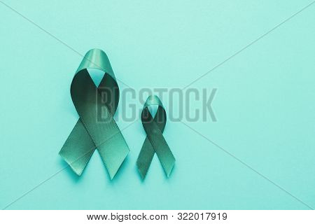 Teal ribbons on blue background, Ovarian Cancer, cervical Cancer, anti bullying and sexual assault awareness poster