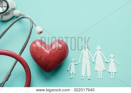 Family Paper Cut Out With Red Heart And Stethoscope, Heart Health,  Family Health Insurance Concept,