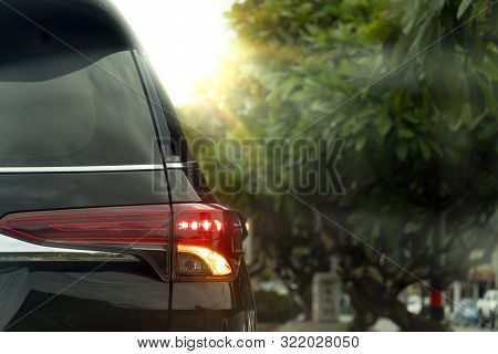 Black Cars Turn On The Side Turn Signal Lights To Wait For A U-turn. On The Side Of The Road There A