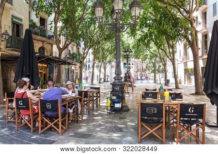 Tourists Enjoying The Sant Agusti Vell Square, In The Center Of Barcelona, In The Gothic And Borne N
