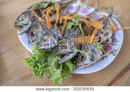Fried Mackerel Placed In A Plate On The Table