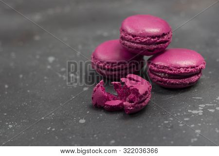 Colorful French Macarons Cookies (macaroons) On A Dark Background. Dessert For Served With Tea Or Co