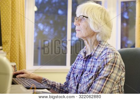 Senior Old Elderly Person Learning Computer And Online Pension And Banking Internet Skills Protect A