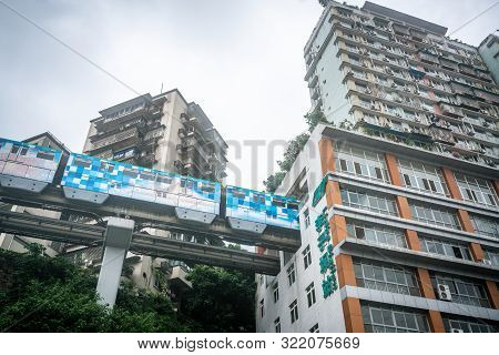Chongqing China, 7 August 2019 : Chongqing Metro Train Entering Liziba Station Famous For Being Insi