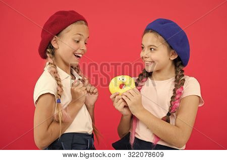 Kids Huge Fans Of Baked Donuts. Share Sweet Donut. Girls In Beret Hats Hold Glazed Donut Red Backgro