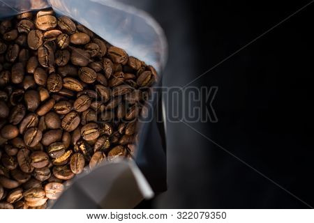 Lots Of Coffee Beans In A Bag On Dark Background. Arabica. Coffee Shop