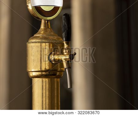 Copper Tap In The Bar For Pouring Beer