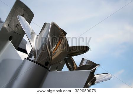New Outboard Engine With Propeller Out The Water Against The Sky