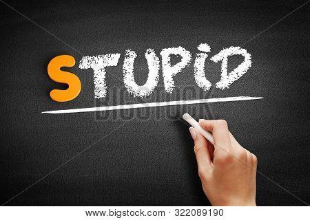 Stupid - Text On Blackboard, Concept Background