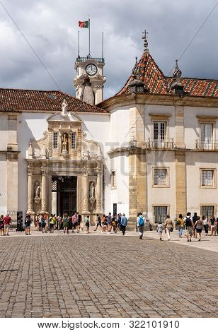 Coimbra, Portugal - 11 August 2019: Tourists Enter The Main Area Of The University Of Coimbra