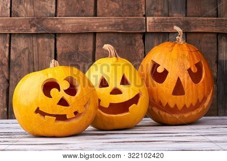 Three Carved Pumpkins For Halloween. Funny And Angry Pumpkins For Halloween. Seasonal Halloween Deco