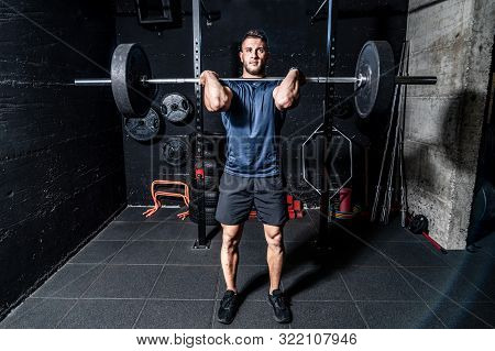 Barbell Weightlifting, Young Strong Fit Muscular Sweaty Man With Big Muscles Doing Heavy Barbell Wei