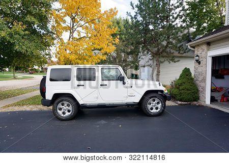 Joliet, Illinois / United States - October 25, 2017: A Brand New White Jeep Sahara Wrangler Unlimite