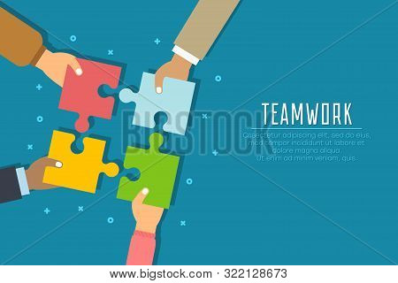 Teamwork Concept. Businessmen Hold In Hands And Connect The Pieces Of Jigsaw Puzzle. Team Work Busin
