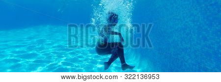 Horizontal Underwater Photography, Moment Of Falling Small Girl In Blue Water Of Swimming Pool, Kid