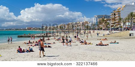 Mallorca, Spain - May 29, 2019: Sandy Beach El Arenal Town, Vacationers Holidaymakers Sunbathing On