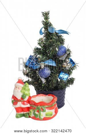 Toy Santa Claus and Christmas tree on a white background