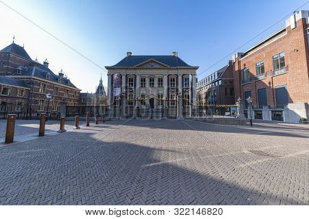 The Hague, 25 August 2019 - Majestic Dutch Parliament Building  And Mauritshuis Entrance Under A Mis