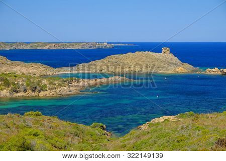 Beautiful Landscape With Lagoons, The Light House Cape Favaritx And The Old Watch Tower Es Colomar C