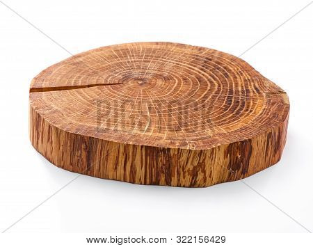 Saw Cut Tree Trunk Cross Section With Annual Rings And Crack Close-up Isolated On White Background