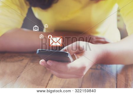 Hand Of Frmale Using Mobile Phone To Open New E-mail Message Inbox With Email Symbol And Envelope Ic