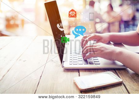 Business Connection Contact Us And Call Center Customer Service Concept. Woman Hand Using Laptop Wit