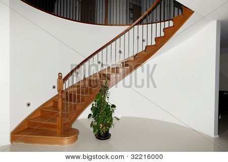 Curved Timber Stairs with Stainless Steel Balustrade poster