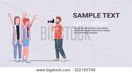 Professional Male Photographer Using Digital Dslr Camera Shooting Girls Models Couple Posing For Pho