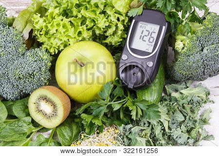 Glucometer For Measuring Sugar Level And Vegetables With Sprouts As Healthy Nutritious Food During D
