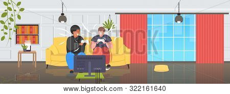 Fat Obese Men Sitting On Couch Using Joystick Game Pad Overweight Mix Race Couple Plying Video Games