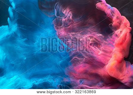 Ink Water Mix. Fantasy Waves. Blue Pink Fluid Flow. Abstract Art Background.