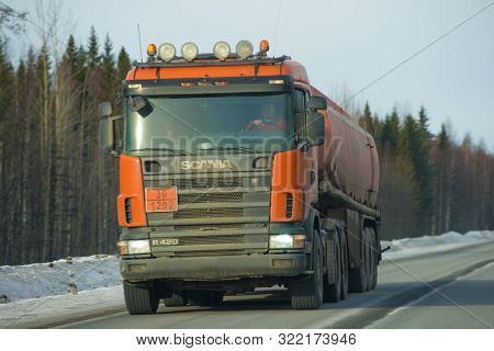 Karelia, Russia - February 18, 2019: Fuel Truck With Scania P420 Truck In Motion On A Winter Road Cl